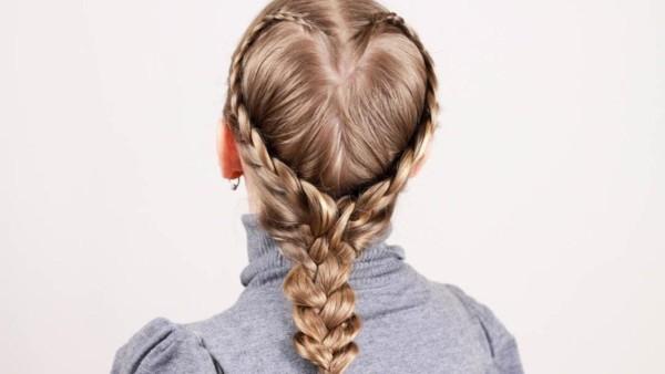 Фото прекрасной прически из кос в форме сердца