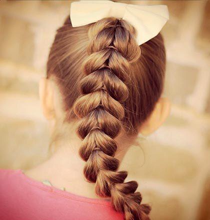 Коса с перевернутыми сердечками – отличный вариант для длинных волос