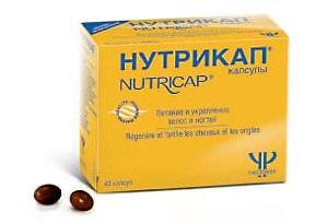 На фото – таблетки Нутрикап