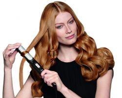На фото – завивка волос утюжком