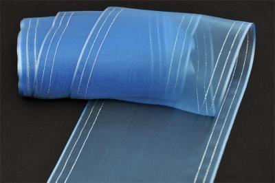 На фото показан вариант голубой капроновой ленточки с продольными декоративными нитями по краям.