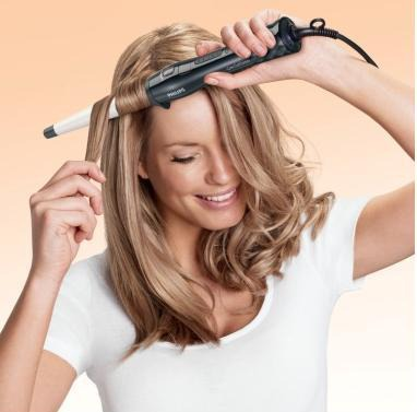 На фото: завивка керамическими щипцами позволяет создавать прически с минимальным вредом для здоровья волос